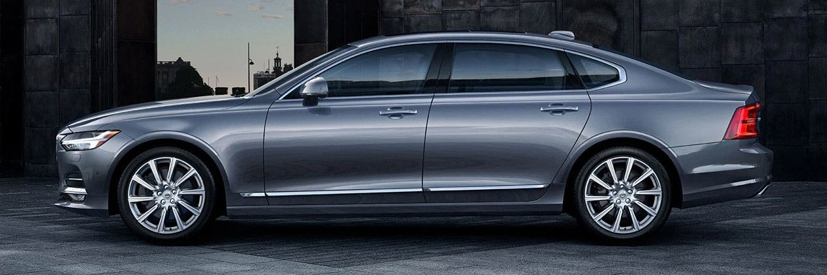 side view of gray Volvo S90 sedan parked on the pavement