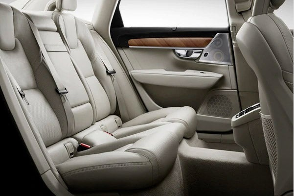 interior back view of Volvo S90 Sedan featuring white leather seats